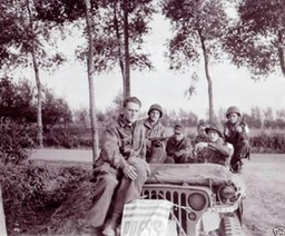 Combat film crew bringing POWs in during Market Garden