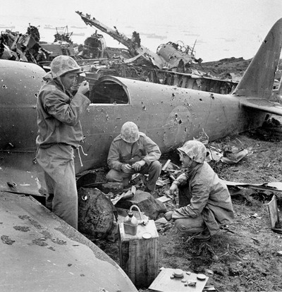 Marines eating C rations on Iwo Jima